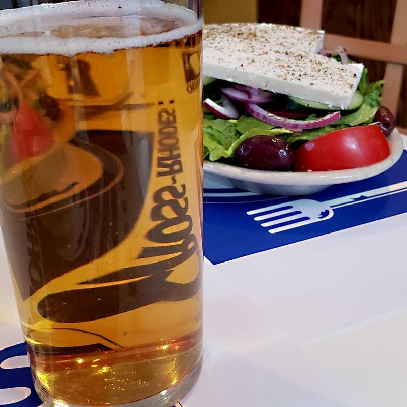 beer and salad at restaurant in evanston cross rhodes