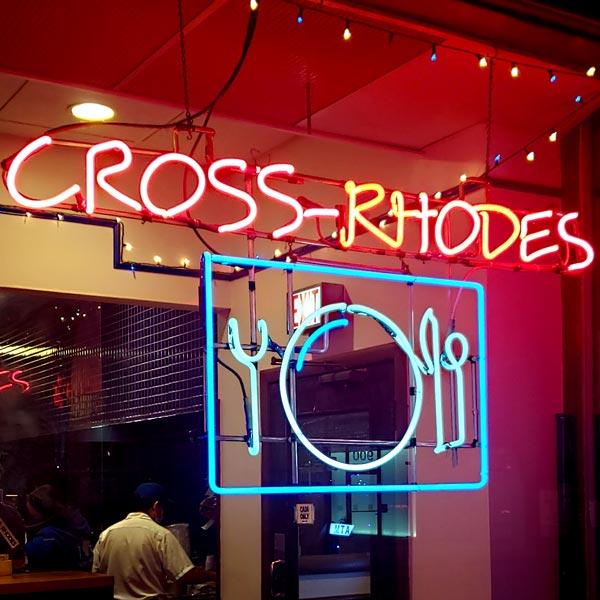 neon cross rhodes restaurant in evanston
